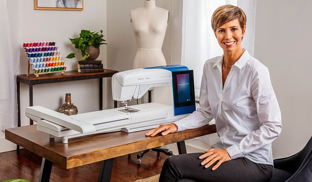 DESIGNER-BRILLIANCE-80-model-standing-with-machine-with-embroidery_612x357.jpg